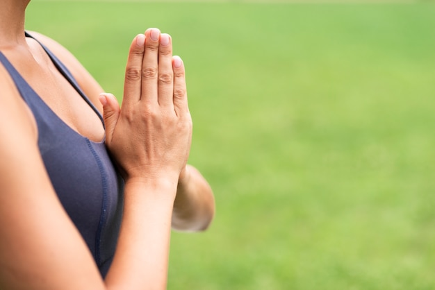 Close-up woman meditating hand gesture outdoors