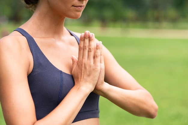 Close-up woman meditating hand gesture