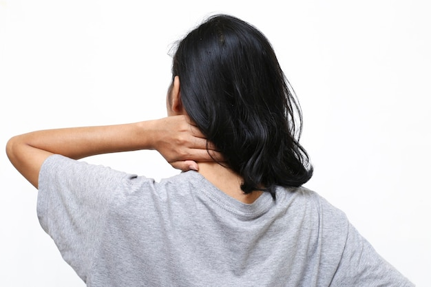 Close up woman neck and shoulder pain and injury. medical concept.