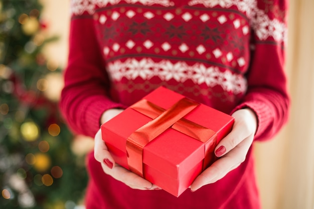 Close up of a woman offering a gift
