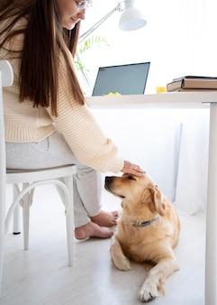 Close up woman petting dog