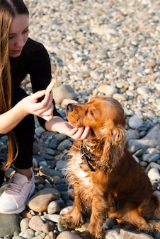 Close-up woman petting her dog