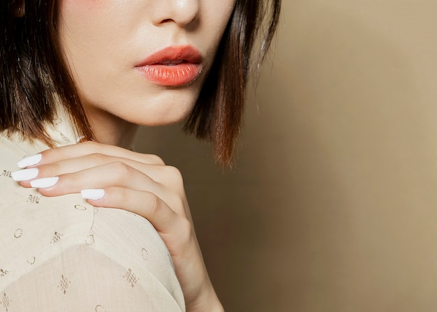 Close-up of woman posing with hand over shoulder