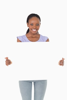 Close up of woman presenting placeholder on white background