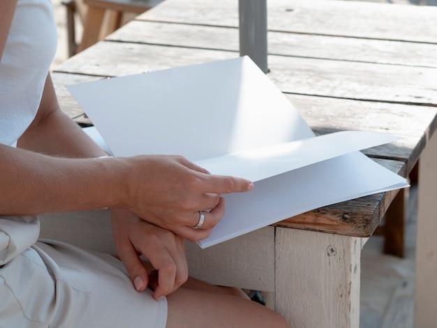 Close-up woman reading a mock-up magazine