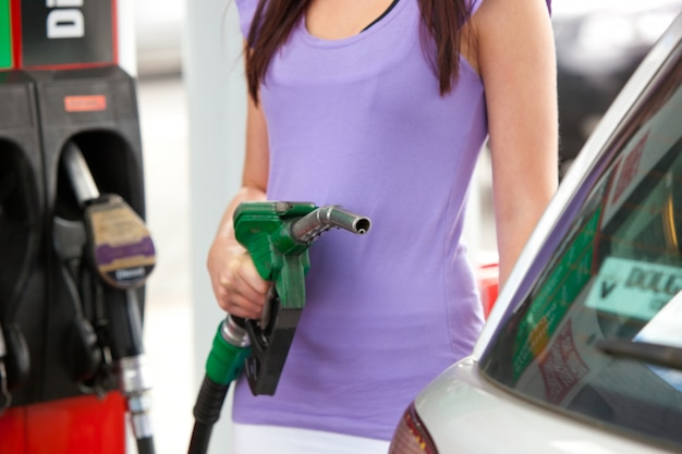 Close up of a woman refueling her car
