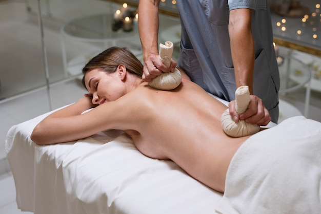 Close up woman relaxing at spa