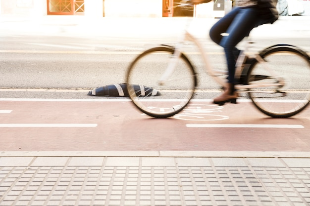 Close up of a woman riding bike in cycle lane