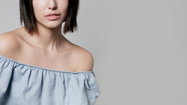 Close-up of woman in ruffle shirt