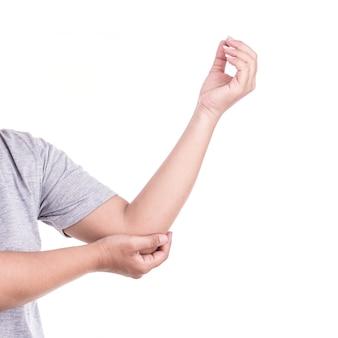 Крупным планом рука женщины, проведение ее локоть, изолированных на белом фоне. концепция боли в локте. Premium Фотографии