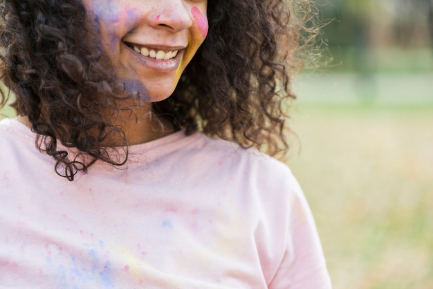 Close-up of woman's smile at holi