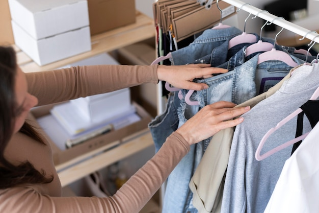 Close up woman searching clothes
