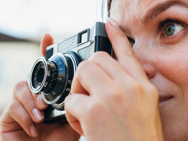 Close-up woman taking photos