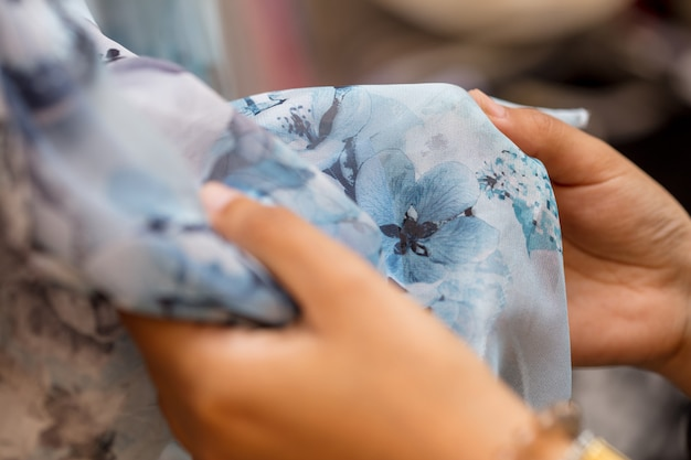 Close up of woman touching clothes