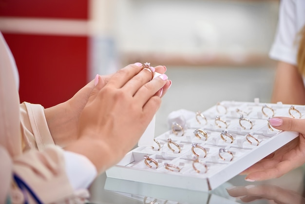 Close up of a woman trying on an engagement ring at the jewelry store