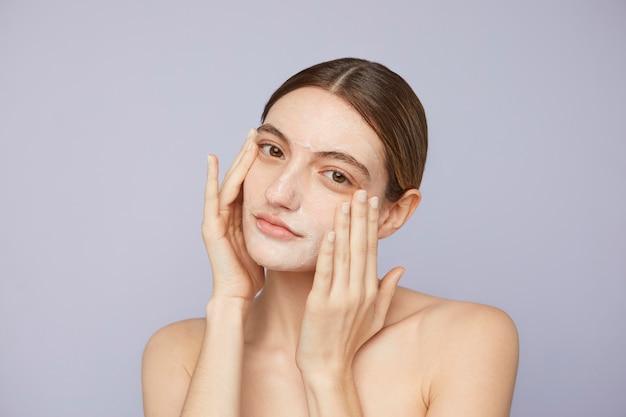 Close up woman using facial mask