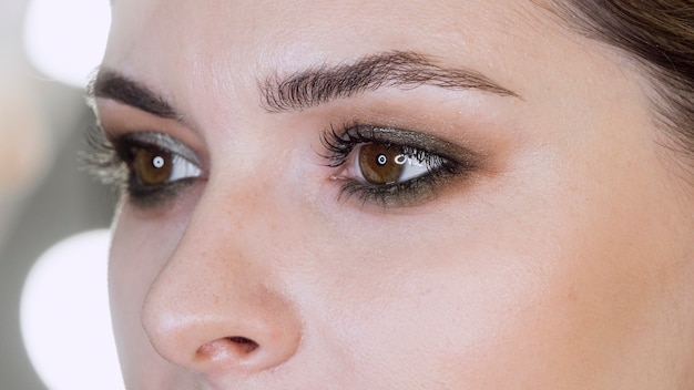 Close up woman wearing eye shadow
