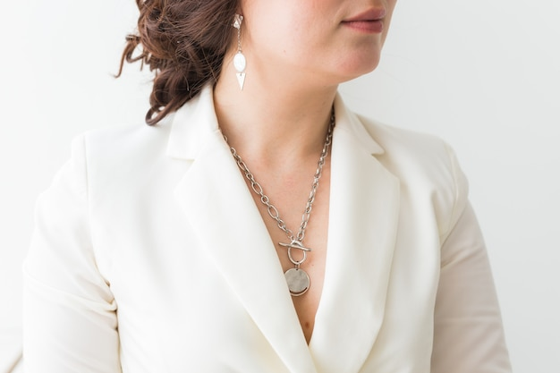 Close-up of woman wearing a jewelry, bijouterie and accessories.