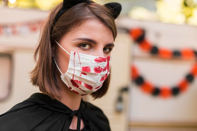 Close-up woman wearing mask