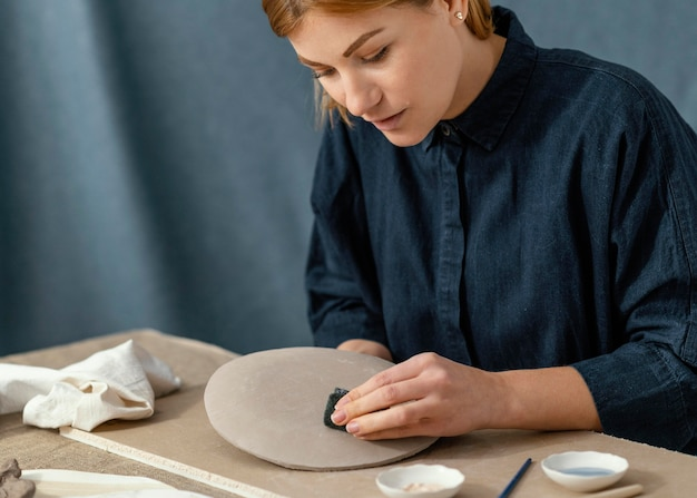 Close-up woman wiping plate