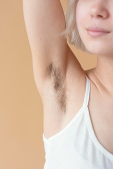 Close up woman with armpit hair