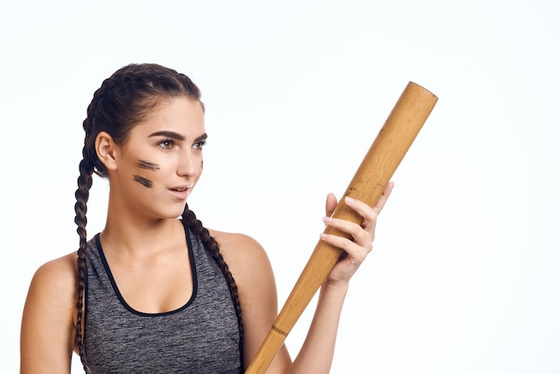 Close up on woman with bat in hands isolated