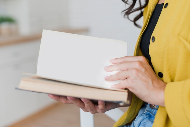 Close-up woman with book indoors