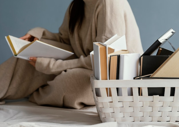 Close up woman with books in basket