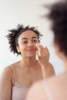 Close up woman with face cream
