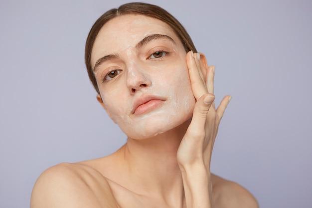 Close up woman with facial mask
