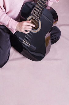 Close up of woman with guitar