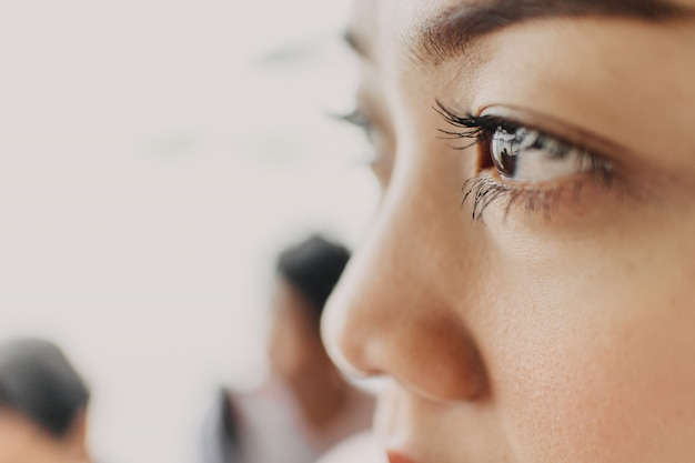 Close up of woman with long and thick eyelash.