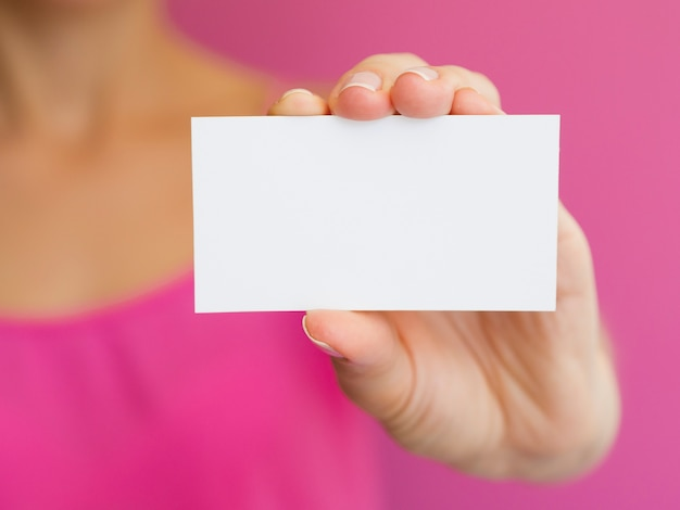 Close-up woman with pink shirt and white card