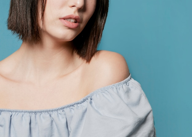 Close-up of woman with ruffle top
