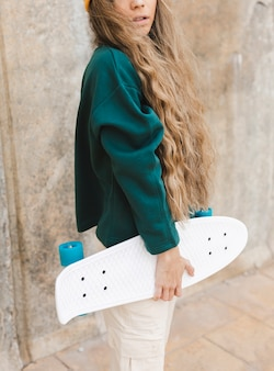 Close-up woman with skateboard