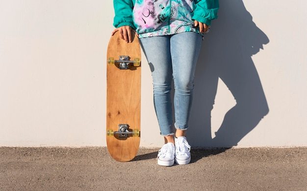 Close up woman with skateboard