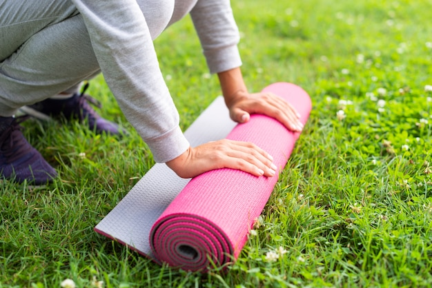 Close-up woman with yoga mat