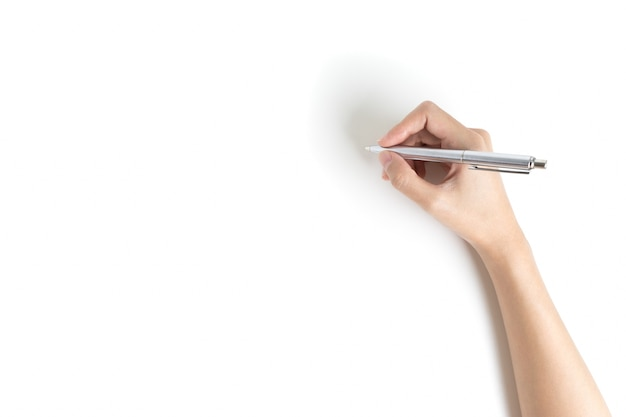 Close up of women arm writing with metallic pen.