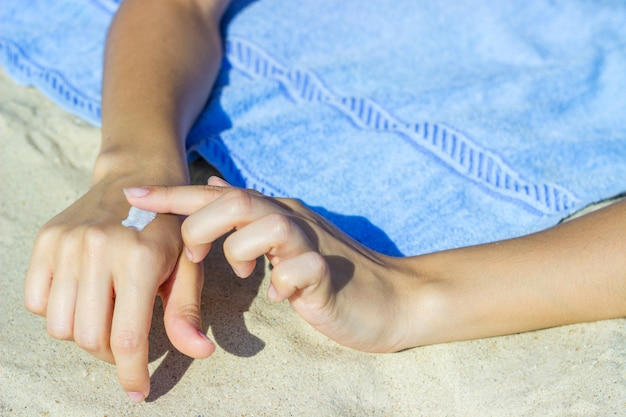 Close up of women hands receiving sunblock cream