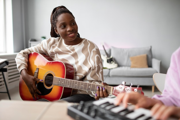 Close up women making music indoors