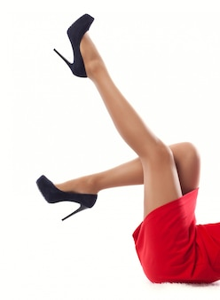 Close up women's slender legs in high heels ,