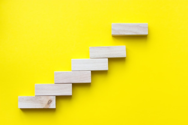 Close up wood block stacking as step stair. business concept growth success process.