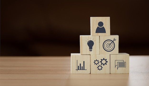 Close up of wood block with business and finance icon background concept. human resource management