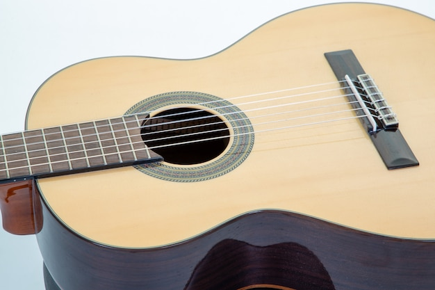 Close up of wooden acoustic guitar