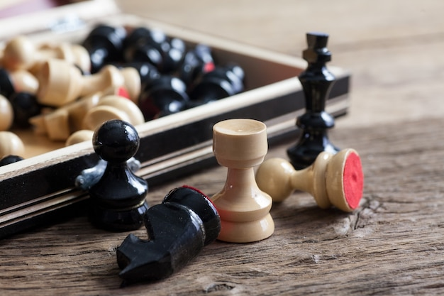 Close up wooden chess pieces on board
