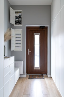 Close-up of a wooden door in the hallway in the style of minimalism.