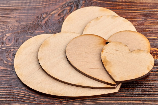 Close up wooden hearts for decoupage.
