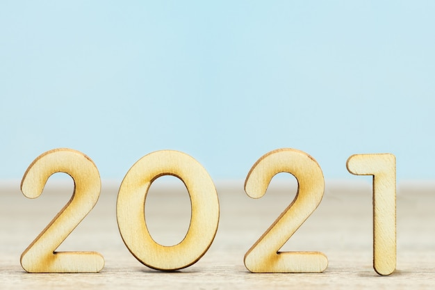 Close up wooden numeric new year 2021 on table with copy space