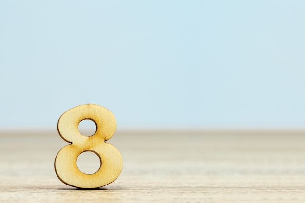 Close up wooden numeric on table with copy space,number eight