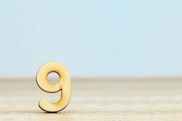 Close up wooden numeric on table with copy space,number nine